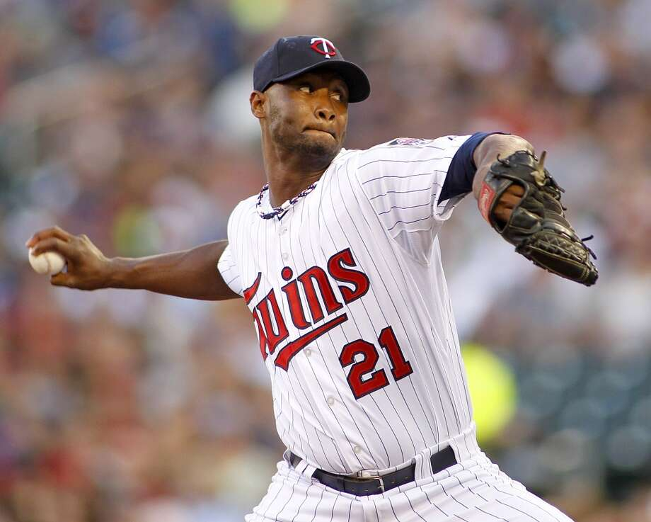 Samuel Deduno throws to the Astros in the first inning. Photo: ANDY CLAYTON-KING, Associated Press