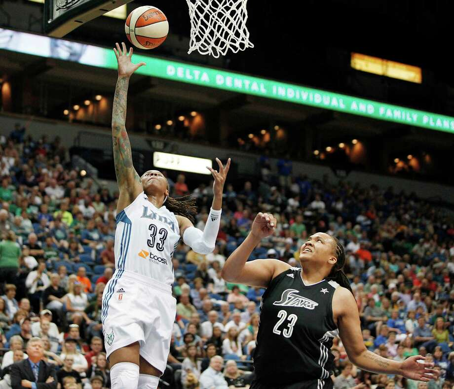 Minnesota Lynx guard Seimone Augustus (33) goes up to the basket past San Antonio Silver Stars forward Danielle Adams (23) during the first half of a WNBA basketball game, Friday, Aug. 2, 2013, in Minneapolis. (AP Photo/Stacy Bengs) Photo: Stacy Bengs, Associated Press / FR170489 AP