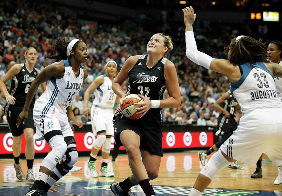 San Antonio Silver Stars center Jayne Appel (32) looks up to the basket against the defense of Minnesota Lynx forward Devereaux Peters (14) and guard Seimone Augustus (33)  in the second half of a WNBA basketball game, Friday, August 2, 2013, in Minneapolis. The Lynx won 85-63. (AP Photo/Stacy Bengs) Photo: Stacy Bengs, Associated Press / FR170489 AP