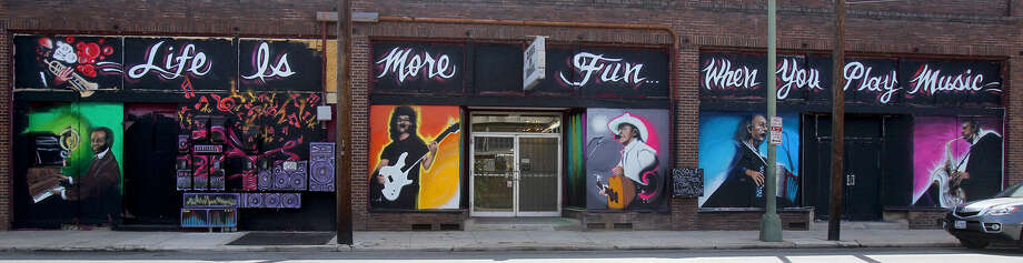 "This is the mural on the back of Alamo Music Center. ""The goal is to make them look like they're all playing on one stage,"" designer Haider ""Banks"" Rashid says. Photo: John Davenport / San Antonio Express-News"