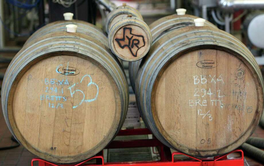 Some special beer is housed in wooden barrels at Saint Arnold Brewing Co. The Houston-based company has been in business for nearly 20 years. Photo: Mayra Beltran, Staff / © 2013 Houston Chronicle