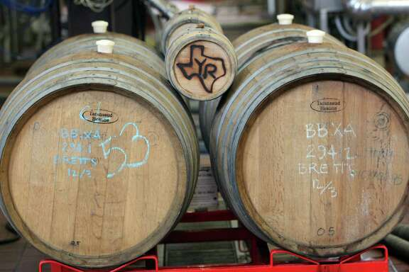 Some special beer is housed in wooden barrels at Saint Arnold Brewing Co. The Houston-based company has been in business for nearly 20 years.