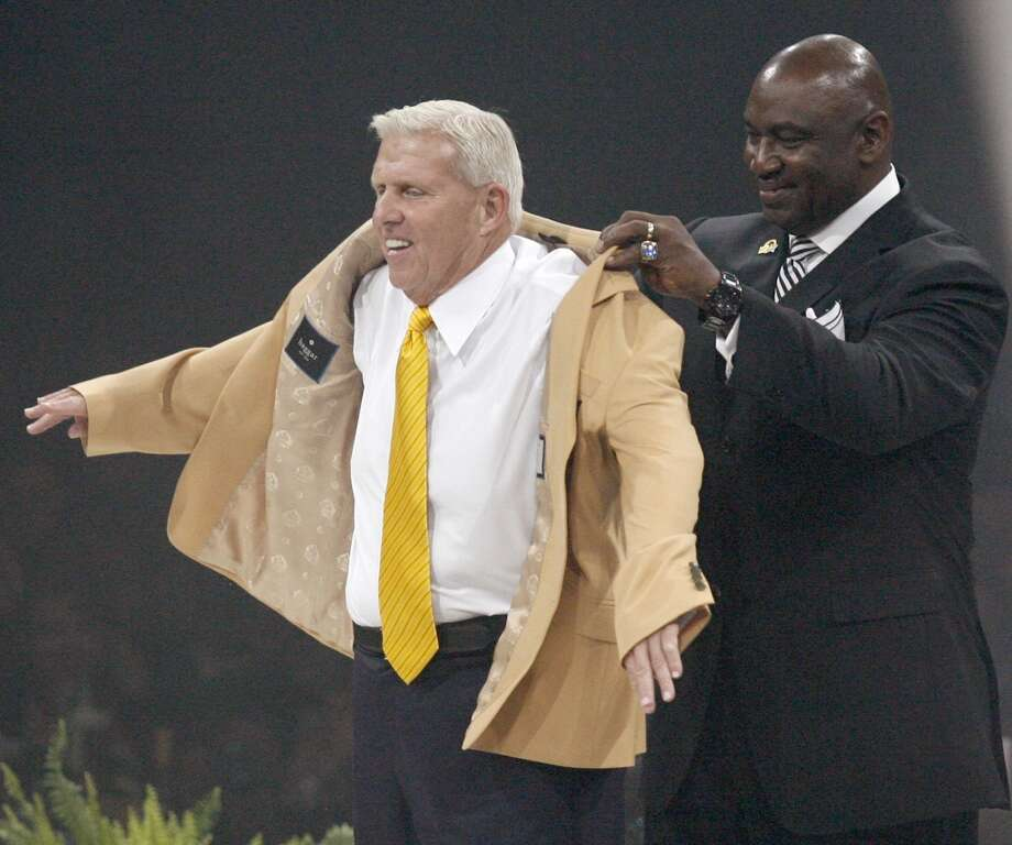 Bill Parcells, left, receives his symbolic gold jacket from his presenter George Martin, right, during the Enshrinees' Gold Jacket Dinner at the Canton Memorial Civic Center Friday, Aug. 2, 2013 in Canton, OH. Parcells will be enshrined into the Pro Football Hall of Fame Saturday.  (AP Photo/The Repository, Scott Heckel) Photo: Scott Heckel, Associated Press