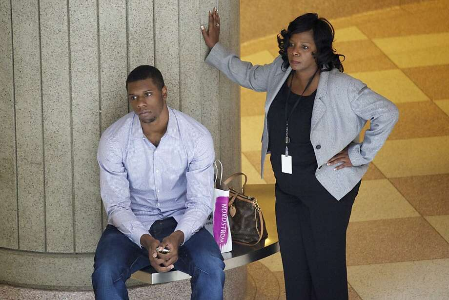 Terrence Jones, with his mother, appeared in court for his arraignment Wednesday. Photo: Mbi, Associated Press