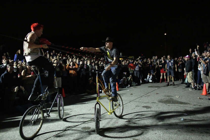 Competitors battle during a bout of tall bike jousting at the 17th annual
