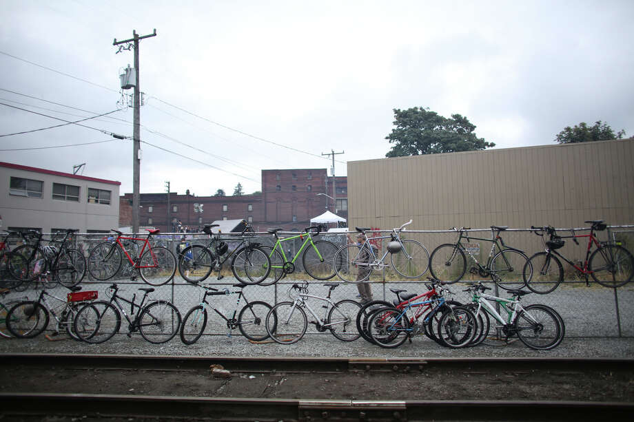 Bikes are secured along a fence. Photo: JOSHUA TRUJILLO, SEATTLEPI.COM / SEATTLEPI.COM