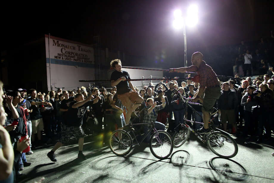Competitors battle during a bout of tall bike jousting. Photo: JOSHUA TRUJILLO, SEATTLEPI.COM / SEATTLEPI.COM