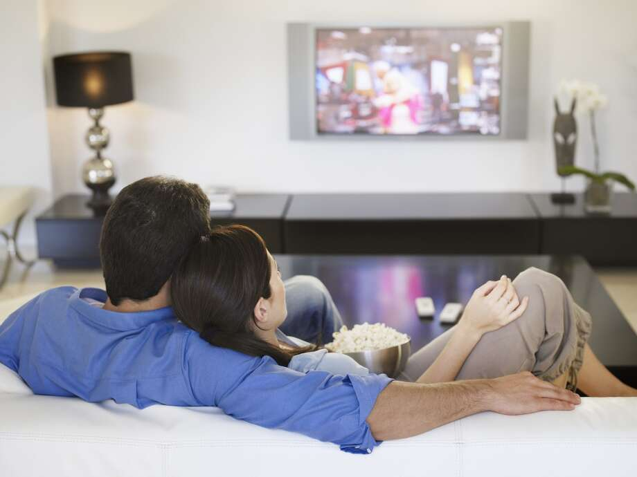 Both men and women say they are likely to engage in sedentary activities, such as watching television when they are stressed out. Experts recommend trying some sort of physical or social activity instead. Photo: Chris Ryan, Getty Images/OJO Images RF