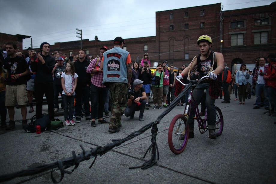 A cyclist prepares to ride in the bike slingshot. Photo: JOSHUA TRUJILLO, SEATTLEPI.COM / SEATTLEPI.COM