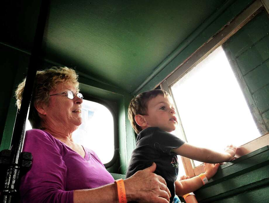 Kathy Prior and her grandson, Eric, 2, of Woodbury, ride in the cupola of a special caboose train, during Danbury Railway Day at the Danbury Railway Museum, Saturday Aug. 3, 2013, in Danbury, Conn. Photo: Michael Duffy / The News-Times