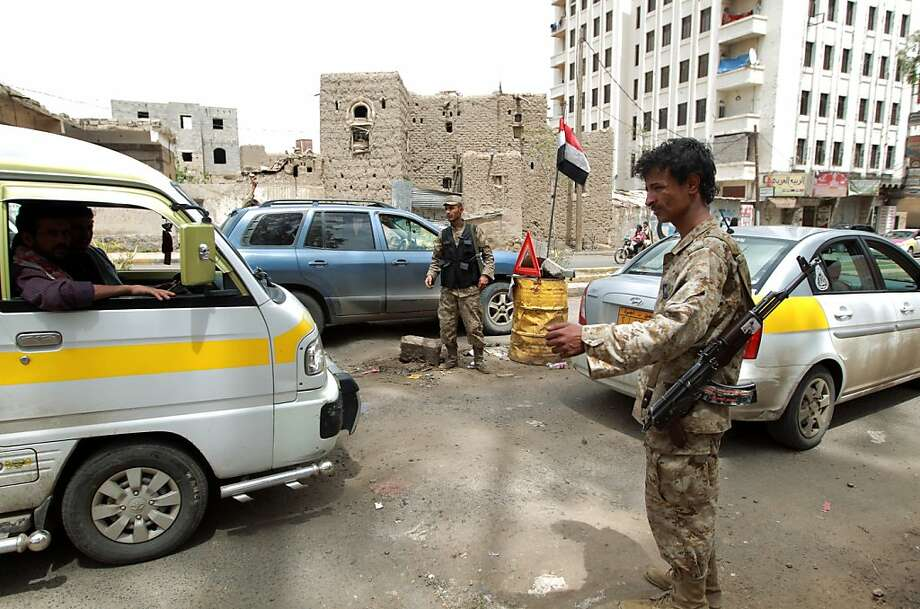 Police man a checkpoint in Sanaa, the capital of Yemen, home of Al Qaeda's most dangerous affiliate blamed for several notable plots against the U.S. Photo: Mohammed Huwais, AFP/Getty Images