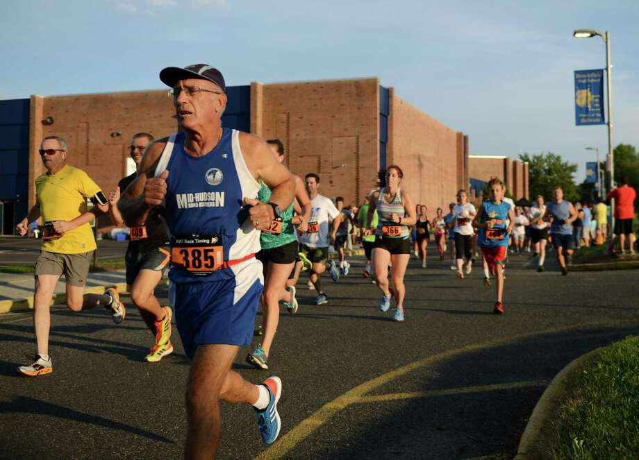 Bill Rosenberg, of Wallkill, N.Y., runs in the First Annual Sunset Sizzler 5K at Brookfield High School in Brookfield, Conn. on Friday, Aug. 2, 2013.  230 runners and walkers participated in the event, raising money for Brookfield High School athletics.  Parker Timmerman, 17, of Brookfield, finished first overall with a time of 16:12, and Rose Willey, 20, of Brookfield, was the first female finisher with a time of 19:08. Photo: Tyler Sizemore / The News-Times