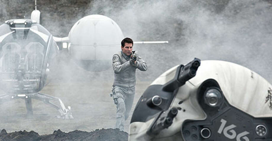 Jack (Tom Cruise) lands to fix a crashed drone. Photo: Http://oblivionmovie.com, 2013, Universal Studios