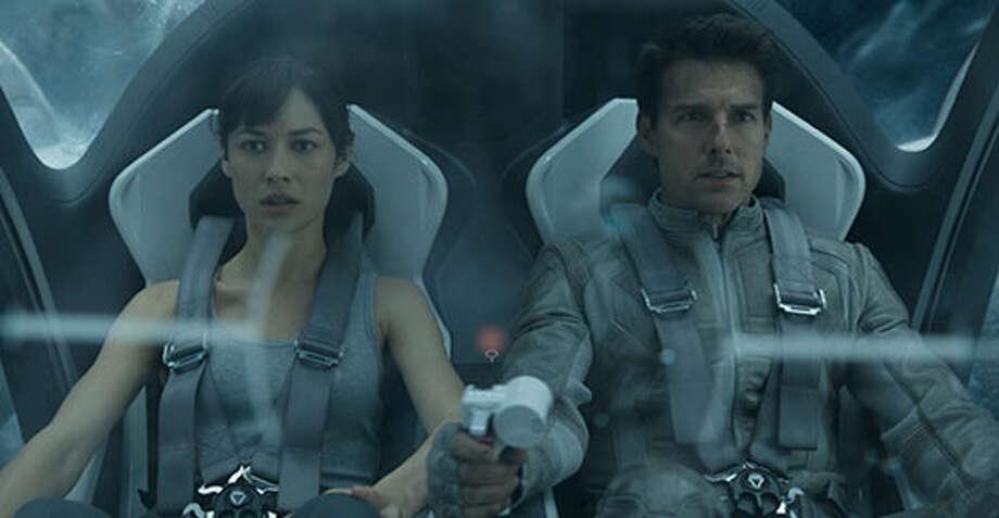 Julia (Olga Kurylenko) and Jack (Tom Cruise) in the Bubbleship. Photo: Http://oblivionmovie.com, 2013, Universal Studios