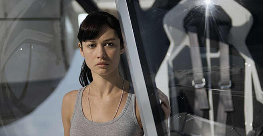 Julia (Olga Kurylenko). Photo: Http://oblivionmovie.com, 2013, Universal Studios