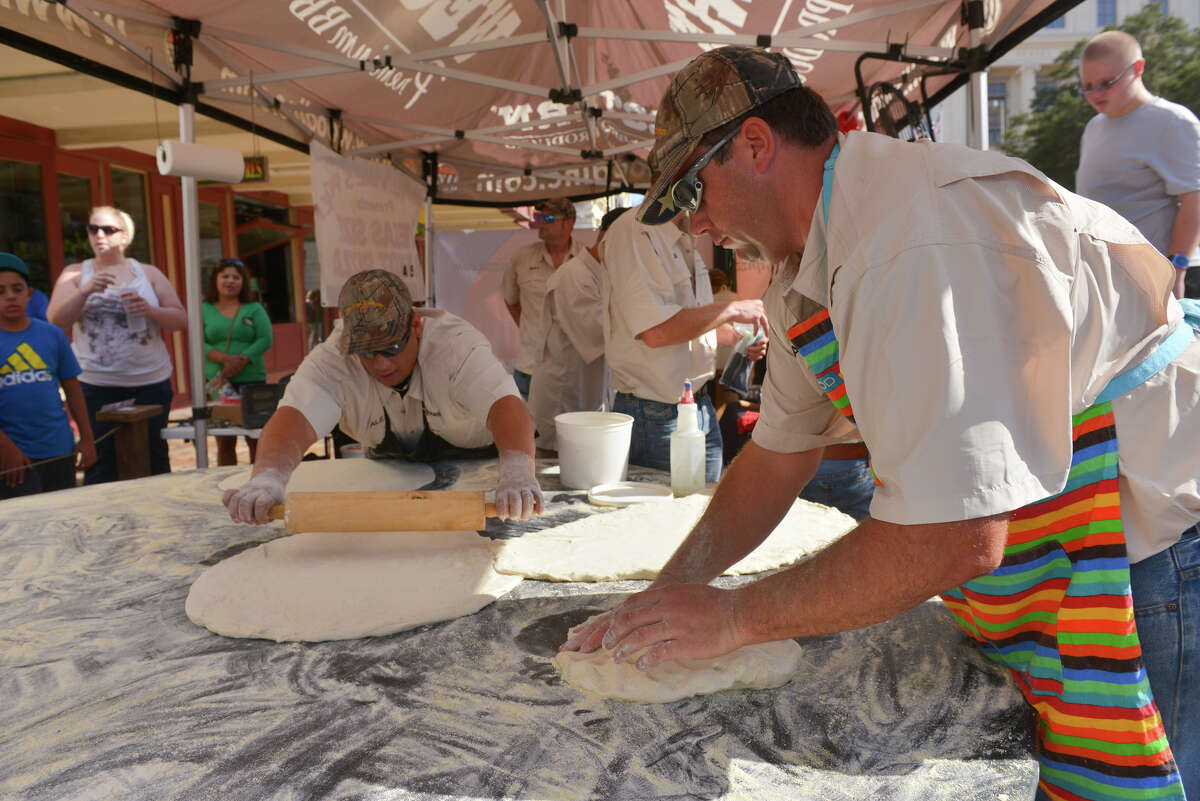Alex Rymers and Warren Haby of Dirt Road Cookers roll out dough during an attempt to snag the Guinness World Record for the