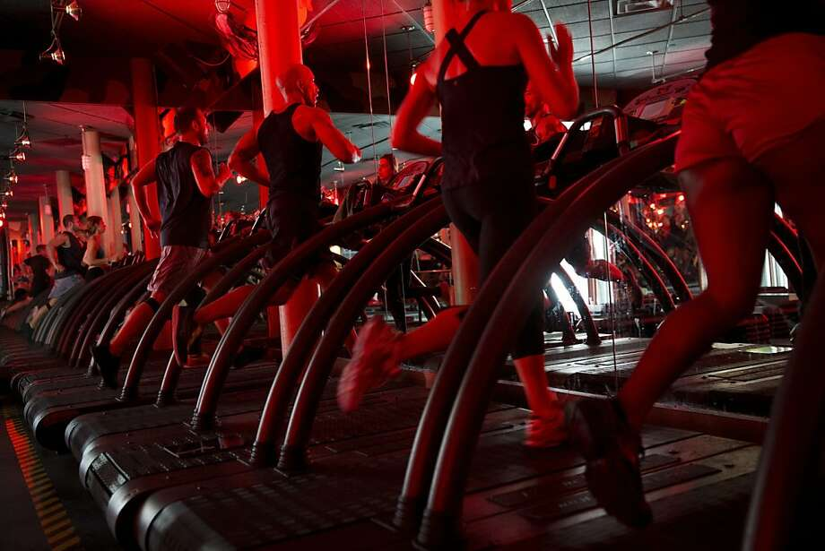 Classes at Manhattan fitness studios are becoming popular with bankers who want to bond with clients. Photo: Scott Eells, Bloomberg