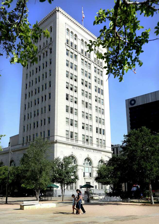The Municipal Plaza Building at 114 W. Commerce, was the home of Frost Bank back in 1922.  Now the building is owned by the city and is where City Council meetings are held, on Wednesday, July 31, 2013.  Frost Bank's current location can be seen at right. Photo: Bob Owen, San Antonio Express-News / © 2012 San Antonio Express-News