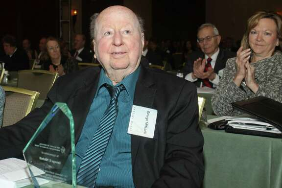 (For the Chronicle/Gary Fountain, January 12, 2012)  Pioneering oilman  and developer George Mitchell, with an award from the annual conference of the Academy of Medicine, Engineering and Science of Texas, where he was honored.