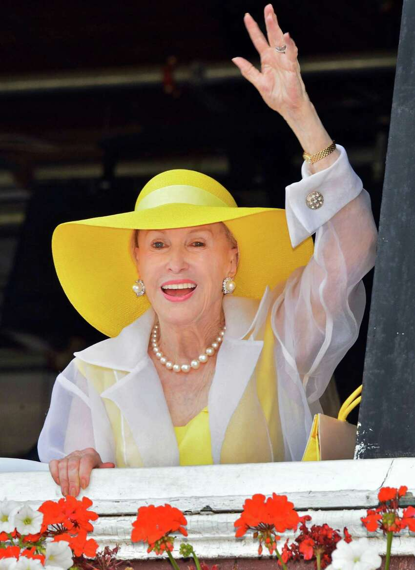 Marylou Whitney waves to fans at Saratoga Race Course Saturday Aug. 3, 2013, in Saratoga Springs, NY. (John Carl D'Annibale / Times Union)