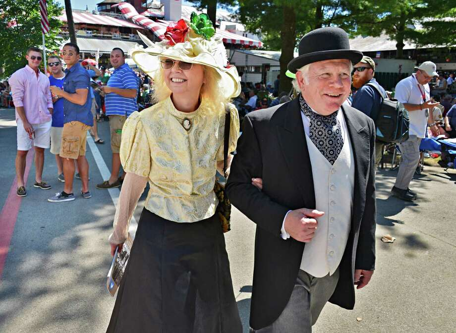 Sandy Graft and Hollis Palmer, both of Saratoga Springs, wear 1860's period dress in honor of Saratoga Race Course's 150th anniversary Saturday Aug. 3, 2013, in Saratoga Springs, NY.   (John Carl D'Annibale / Times Union) Photo: John Carl D'Annibale / 10023367A