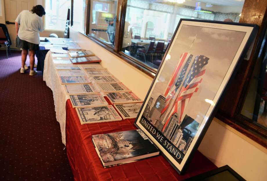 A special 9/11 exhibit with artifacts and memorabilia from the Twin Towers is displayed at the Danbury Italian Festival at the Amerigo Vespucci Lodge in Danbury, Conn. on Saturday, August 3, 2013.  The three-day festival featured authentic Italian food, music and rides for children.  Donations from the 9/11 exhibit went to the Wounded Warriors Project. Photo: Tyler Sizemore / The News-Times