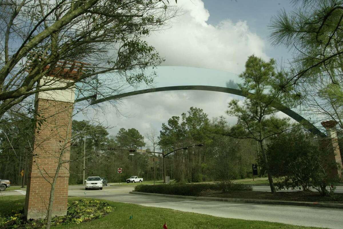 A tasteful and understated archway leads to the Grogan's Mill Village Center in The Woodlands, which was the first village to open in the community in 1974.