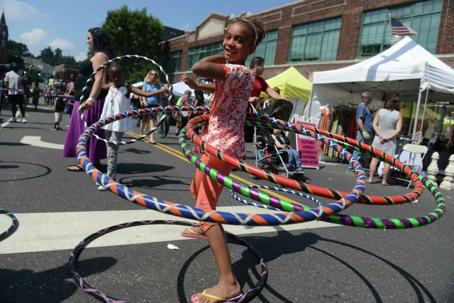 Jianna Blunschi,  7, of Weston, hula hoops during the 38th annual SoNo Arts Celebration Saturday, Aug. 3, 2013 in Norwalk's Historic District at S. Main and Washington streets. Photo: Autumn Driscoll / Connecticut Post