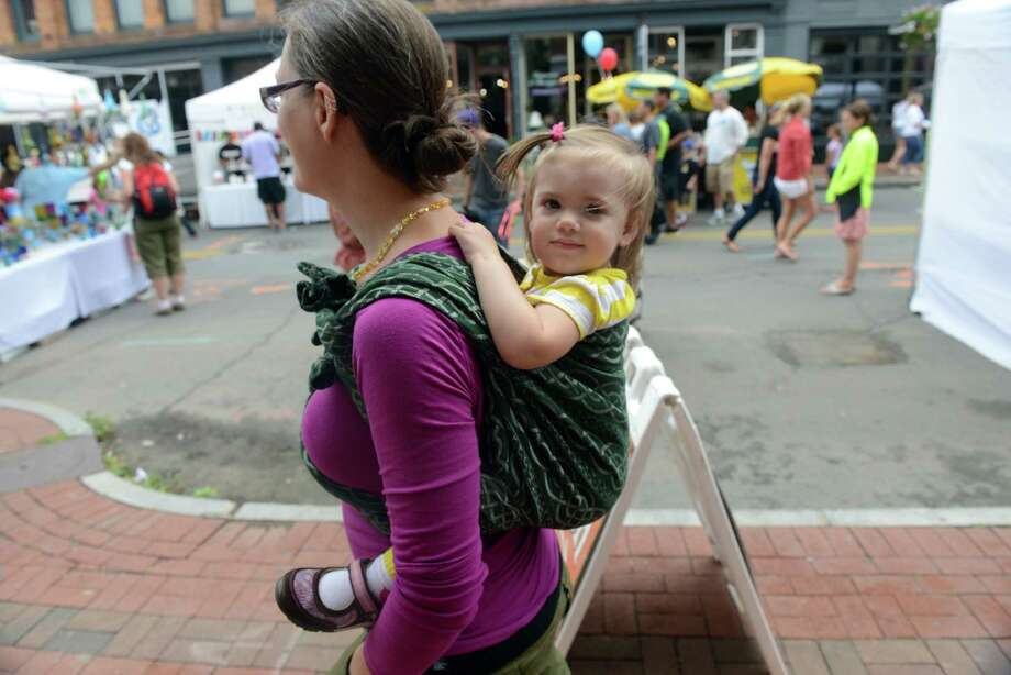 Kristin Baningoso and 16-month-old daughter Eloise, of Trumbull, enjoy the 38th annual SoNo Arts Celebration Saturday, Aug. 3, 2013 in Norwalk's Historic District at S. Main and Washington streets. Photo: Autumn Driscoll / Connecticut Post