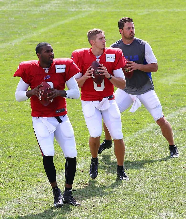 Bills quarterbacks EJ Manuel (left), Jeff Tuel and Kevin Kolb do a passing drill Tuesday. Photo: Bill Wippert, Associated Press
