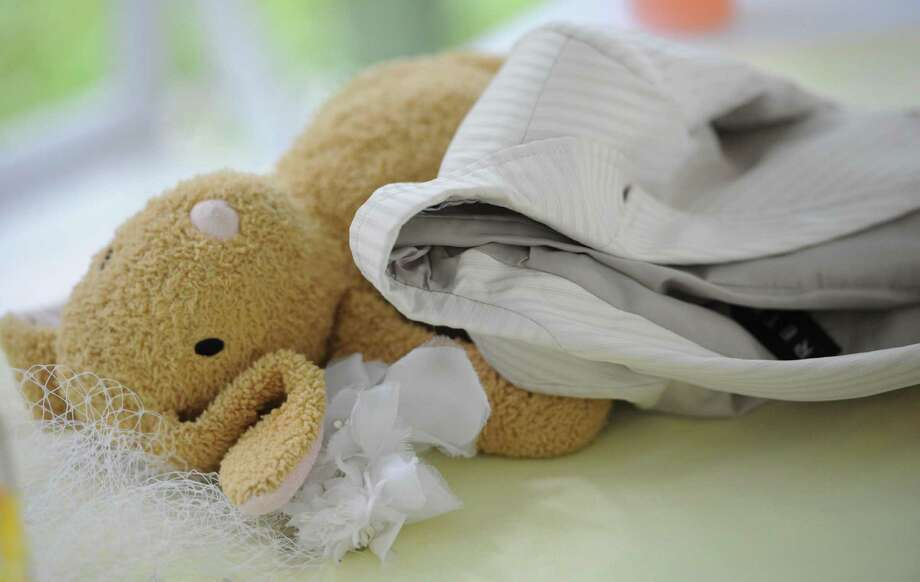 Logan Stevenson's stuffed toy, Bun Bun, rests on a table with his suit jacket after his parent's wedding ceremony on Saturday, Aug. 3, 2013 in Jeannette, Pa. Photo: Eric Schmadel, Associated Press / Tribune Review