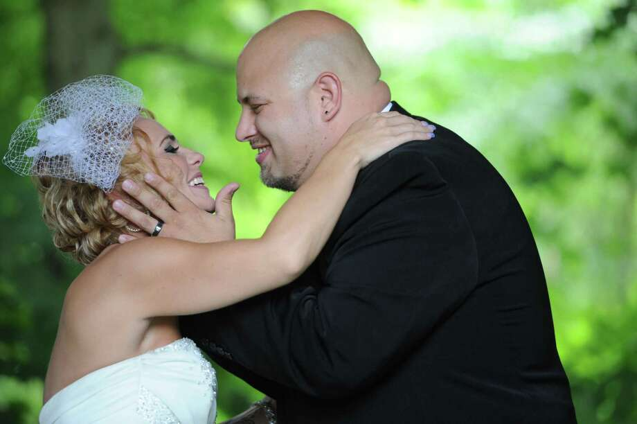 Newlywed Christine Stevenson and Sean Stevenson smile after sharing their first kiss at the wedding ceremony on Saturday, Aug. 3, 2013 in Jeannette, Pa. Photo: Eric Schmadel, Associated Press / Tribune Review
