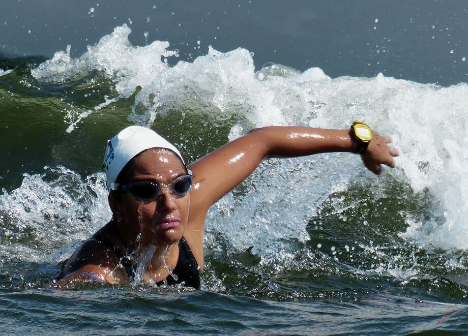 Nora Toledano, one of two swimmers from Mexico, competes in the St. Vincent's Swim Across the Sound Marathon in Bridgeport, Conn. on Saturday August 3, 2013. Photo: Christian Abraham / Connecticut Post