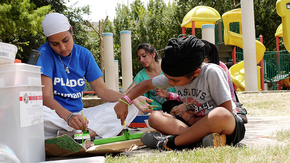 Inderpal Singh Gumer, 70, joined fellow Sikhs at Dodson Elementary to clean and care for the school's garden.