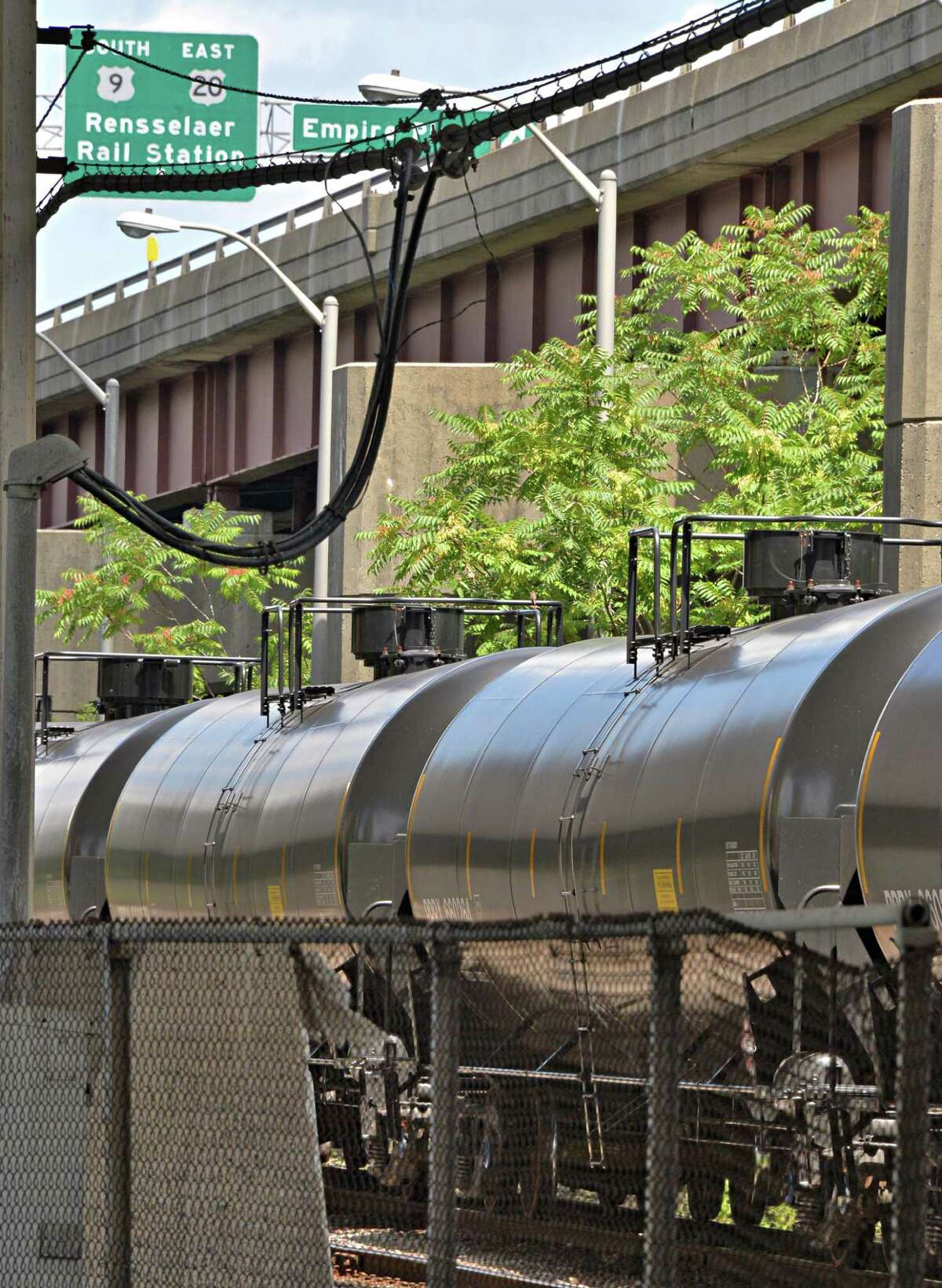 Railroad oil tanker cars under I-787 in Albany, NY, Tuesday July 30, 2013. (John Carl D'Annibale / Times Union)
