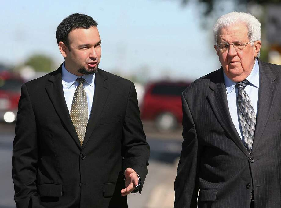 Jonathan Treviño (left), seen walking with attorney Robert Yzaguirre, is the son of Hidalgo County Sheriff Lupe Treviño. Photo: Joel Martinez, AP / The Monitor