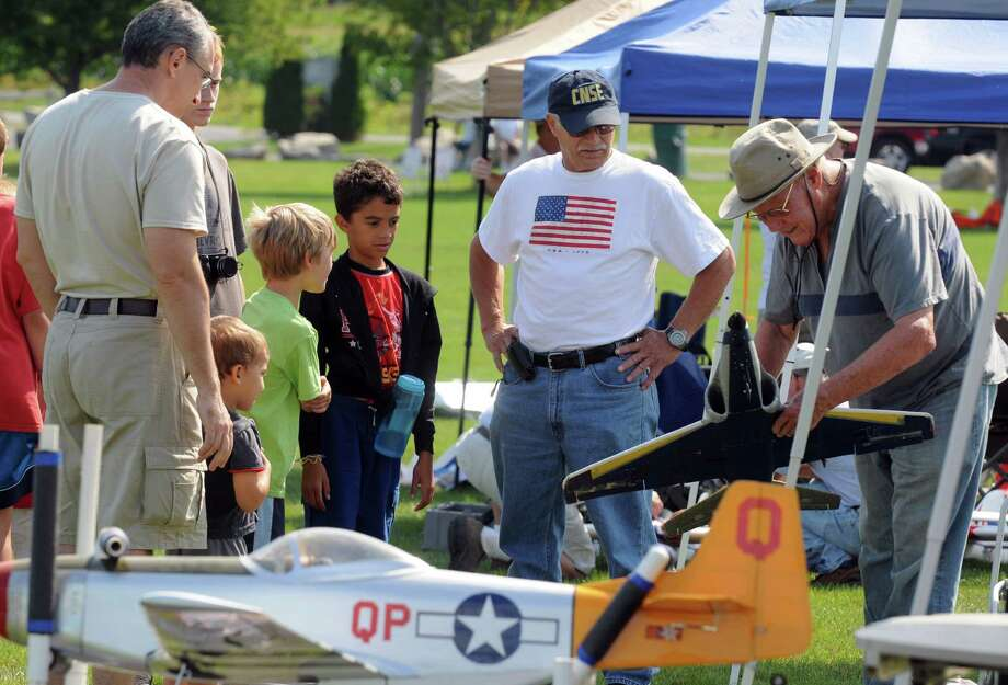 Art Arro of Utica, right, talks to a group about his models during the all-electric radio control model airplane event at Maalwyck Park on Saturday Aug. 3, 2013 in Glenville, N.Y. Presented by the Electric Powered Aeromodelers Club of Glenville.(Michael P. Farrell/Times Union) Photo: Michael P. Farrell / 00023331B