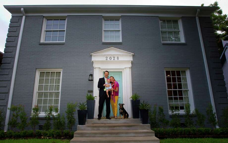 Bevin Bering Dubrowski, right, stands with her husband, Dan, and baby, Edith, along with their dog, Grover, in front of their home, Wednesday, July 17, 2013, in Houston. (Cody Duty / Houston Chronicle) Photo: Cody Duty, Staff / © 2013 Houston Chronicle