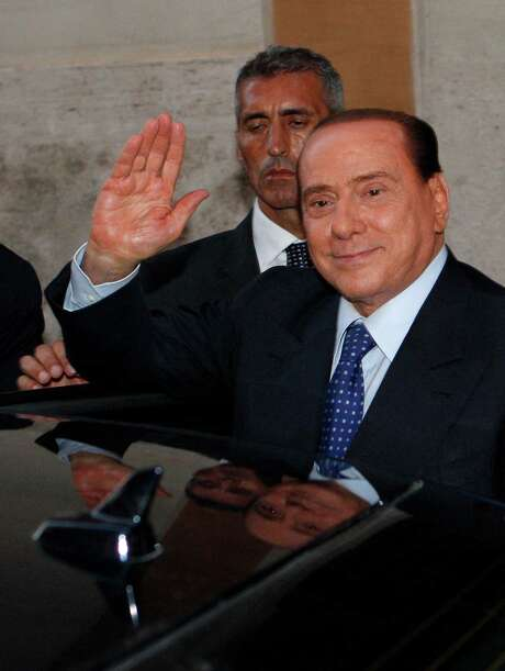 "Italian former Premier Silvio Berlusconi waves to reporters as he leaves after attending a meeting with the People of Freedom party's lawmakers at the Lower Chamber in Rome, Friday, Aug. 2, 2013. Italy's former premier, Silvio Berlusconi, for the first time in decades of criminal prosecutions related to his media empire was definitively convicted of tax fraud and sentenced to prison by the nation's highest court, Judge Antonio Esposito, in reading the court's decision Thursday, declared Berlusconi's conviction and four-year prison term ""irrevocable."" He also ordered another court to review the length of a ban on public office ? the most incendiary element of the conviction because it threatens to interrupt, if not end, Berlusconi's political career. (AP Photo/Riccardo De Luca) Photo: Riccardo De Luca, STR / AP"