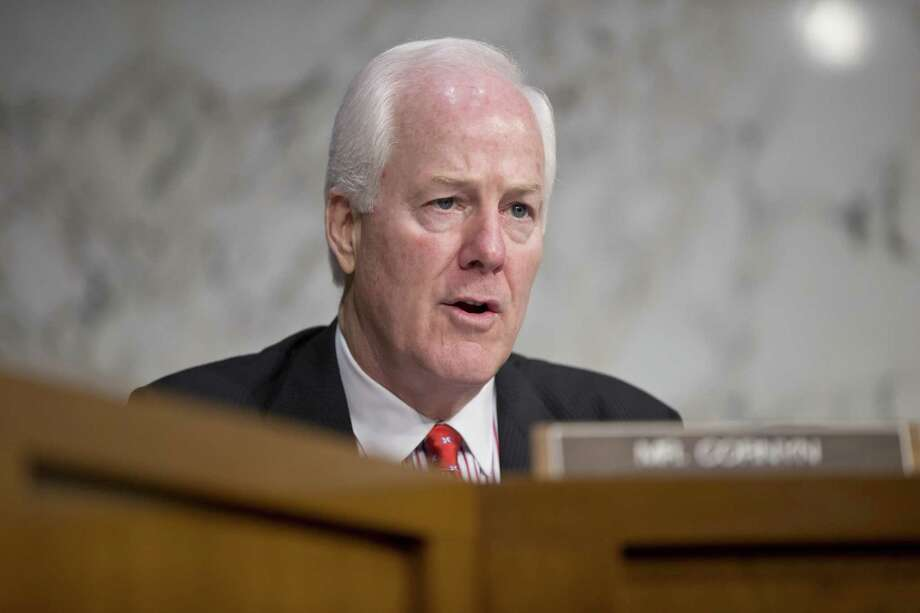 Sen. John Cornyn, R-Texas, speaks during the Senate Judiciary Committee hearing Wednesday questioning top Obama administration officials about the National Security Agency's surveillance programs. Photo: J. Scott Applewhite / Associated Press