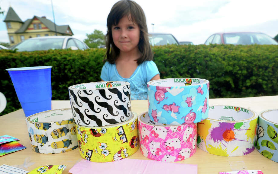 Hillary Hickey, 6, sells cartoon duct tape in front of her mom's shop A Shore Thing during St. Vincent's Swim Across the Sound Marathon at Captain's Cove Seaport in Bridgeport, Conn. on Saturday August 3, 2013. Photo: Christian Abraham / Connecticut Post