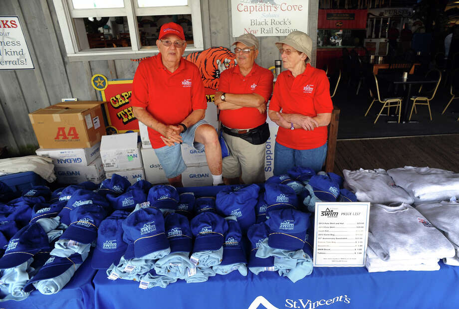 Volunteers Ken Sherbo, left, Bruno Goldschmidt, center, and Jan Sherbo, at St. Vincent's Swim Across the Sound Marathon at Captain's Cove Seaport in Bridgeport, Conn. on Saturday August 3, 2013. Photo: Christian Abraham / Connecticut Post