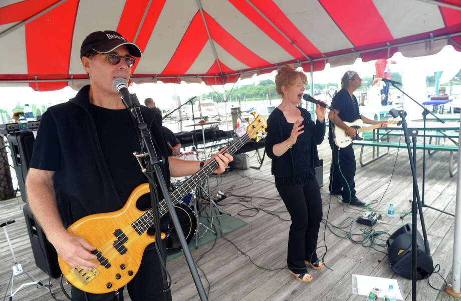 The band Side B performs at St. Vincent's Swim Across the Sound Marathon at Captain's Cove Seaport in Bridgeport, Conn. on Saturday August 3, 2013. At left is bassist Robert Miller, on vocals is Pam Brennan, on guitar is Rob Michael, and in back is drummer Chris Scott. Photo: Christian Abraham / Connecticut Post