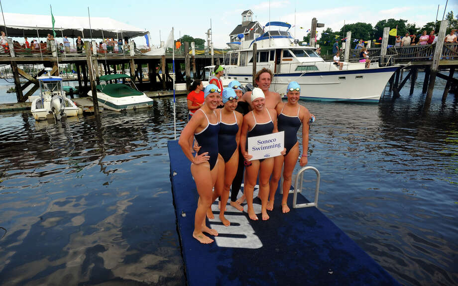 Members of team Sonoco Swimming from Southern Connecticut State University after competing in St. Vincent's Swim Across the Sound Marathon at Captain's Cove Seaport in Bridgeport, Conn. on Saturday August 3, 2013. Photo: Christian Abraham / Connecticut Post