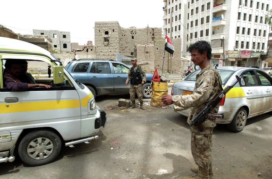 Yemeni police run a checkpoint Saturday in the capital, Saana, in response to a worldwide warning from the United States of possible al-Qaida attacks across the Islamic world. Photo: MOHAMMED HUWAIS, Stringer / AFP