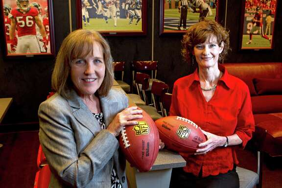 Marilan Logan, left, Texans vice president and chief accounting officer, and Suzie Thomas, executive vice president, general counsel and chief administrative officer, help call plays on the business side.