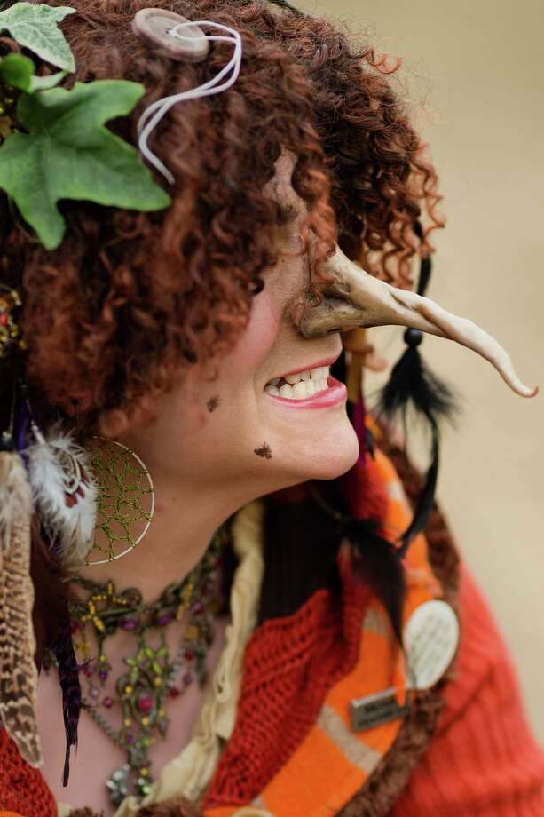 A witch snarls at a passerby during The Washington Midsummer Renaissance Faire Saturday, August 3, 2013, at The Kelley Farm in Bonney Lake. The event continues August 10-11 and 17-18. Photo: JORDAN STEAD, SEATTLEPI.COM / SEATTLEPI.COM