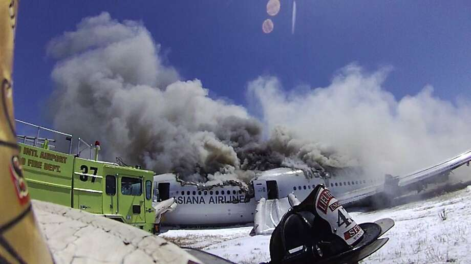 An image from the helmet-mounted video camera of a San Francisco fire battalion chief  at the scene of the crash of Asiana Flight 214 at San Francisco International Airport on July 6, 2013 in San Francisco, California. The image shows a foam-spraying fire rig number 37, driven by Elyse Duckett, that ran over a 16-year-old Chinese passenger, Ye Meng Yuan, seconds later.