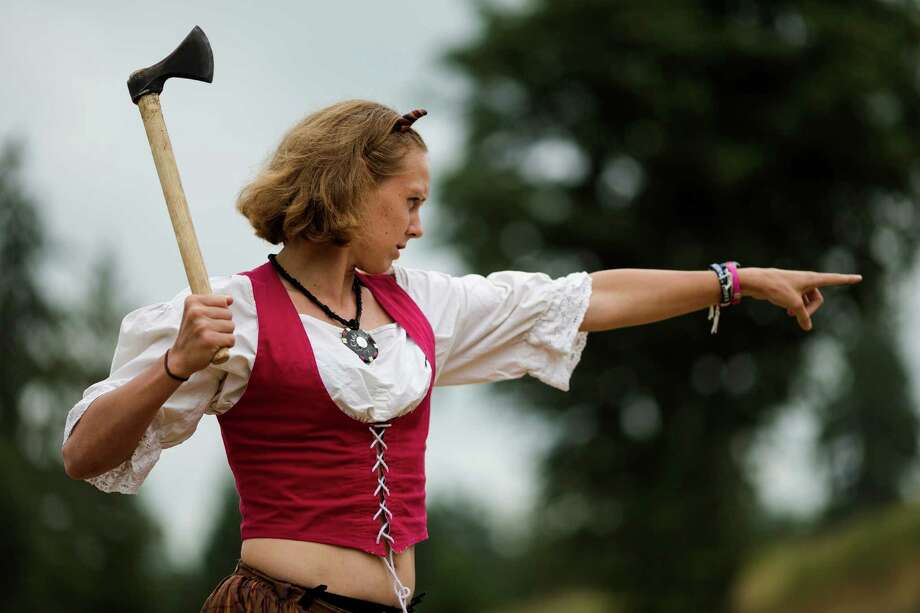 Professional Frisbee player Charlie Mercer, of Washington, D.C., practices her axe-throwing at wooden targets during The Washington Midsummer Renaissance Faire Saturday, August 3, 2013, at The Kelley Farm in Bonney Lake. The event continues August 10-11 and 17-18. Photo: JORDAN STEAD, SEATTLEPI.COM / SEATTLEPI.COM