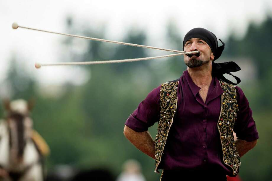 A member of the Ma'Ceo Gypsy Horse Extravaganza presented by Cavallo Equestrian Arts spins two end-weighted ropes in rapid succession from his mouth during The Washington Midsummer Renaissance Faire Saturday, August 3, 2013, at The Kelley Farm in Bonney Lake. The event continues August 10-11 and 17-18. Photo: JORDAN STEAD, SEATTLEPI.COM / SEATTLEPI.COM
